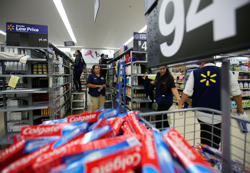 Walmart hikes minimum wage, announces layoffs on same day By Reuters