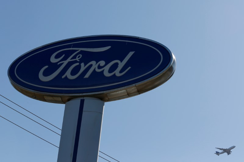 © Reuters. FILE PHOTO: An airplane flies above a Ford logo in Colma, California