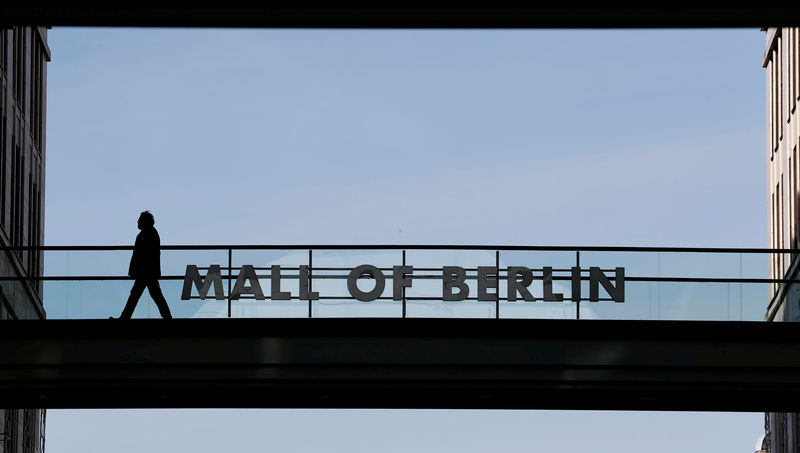 © Reuters. FILE PHOTO: A man walks at the LP12 Mall of Berlin shopping mall is in Berlin