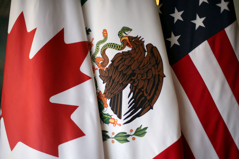 © Reuters. FILE PHOTO: Flags are pictured during the fifth round of NAFTA talks involving the United States Mexico and Canada in Mexico City