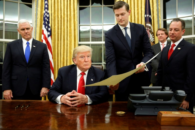© Reuters. FILE PHOTO: Porter hands document to Trump during signing ceremony in the Oval Office in Washington