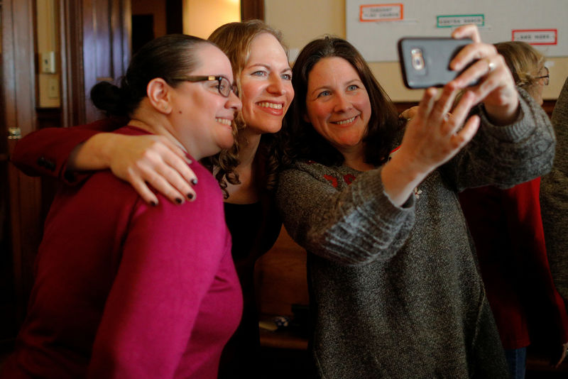 © Reuters. Democratic candidate for the U.S. Congress Alexandra Chandler poses for a selfie with voters after the Greater Haverhill Indivisible candidates forum in Haverhill