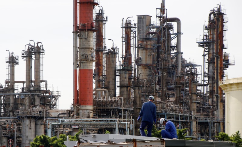 TOKYO (Reuters) - Confidence among Japanese manufacturers edged up in March from three months ago and the service sector's mood hit a three-year high, the Reuters Tankan poll showed on Tuesday.