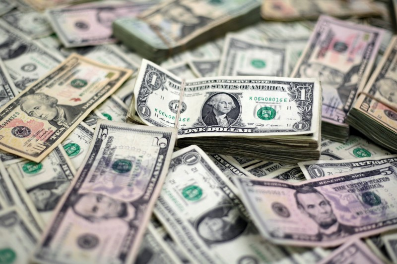 Dollar on defensive after Fed, trade worries hit shares