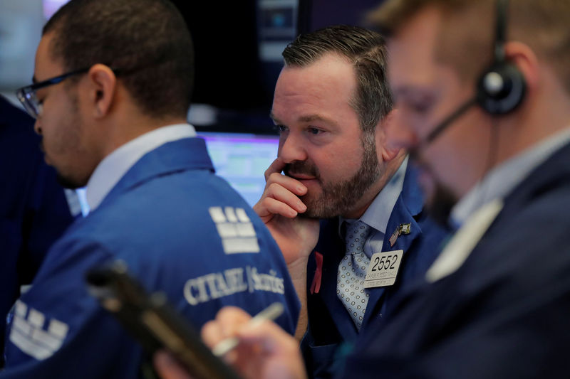 Wall Street closes lower in rocky session on Amazon losses