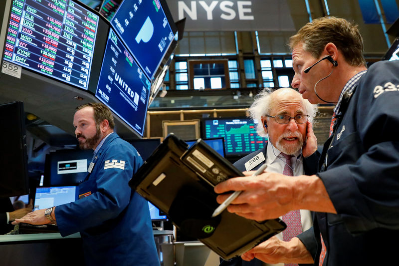 Wall Street rises but pares gains late after report of FBI raid