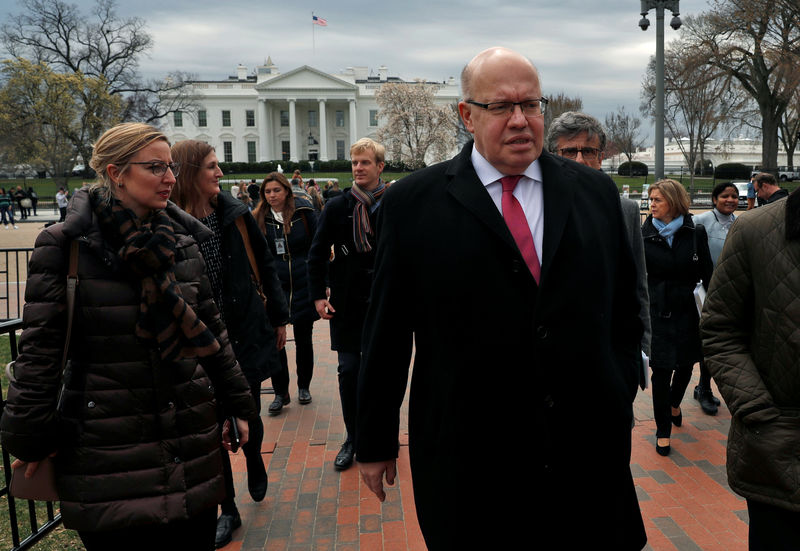 © Reuters. German Economic Minister Peter Altmaier walks after delivering a statement regarding the Trump Administration's steel and aluminum tariffs outside of the White House in Washington