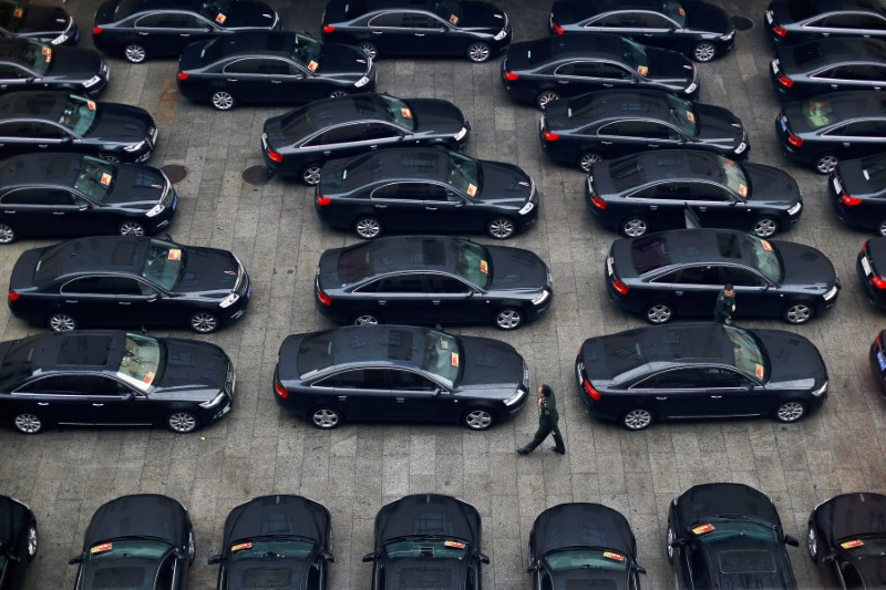 © Reuters. FILE PHOTO: Cars are parked at the Great Hall of the People during the opening session of the 19th National Congress of the Communist Party of China in Beijing