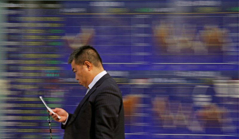 Asia tech shares spooked by phone warning, oil near highs