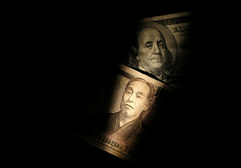 © Reuters. FILE PHOTO: Light is cast on U.S. one-hundred dollar bill next to Japanese 10,000 yen note