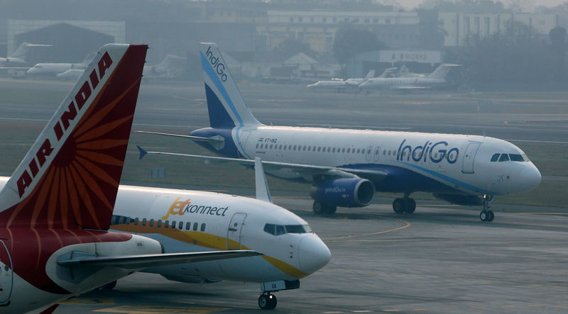 © Reuters. FILE PHOTO: An IndiGo Airlines Airbust A320 aircraft and JetKonnect Boeing 737 aircraft taxi past an Air India Airbus A321 aircraft at Mumbai's Chhatrapathi Shivaji International Airport