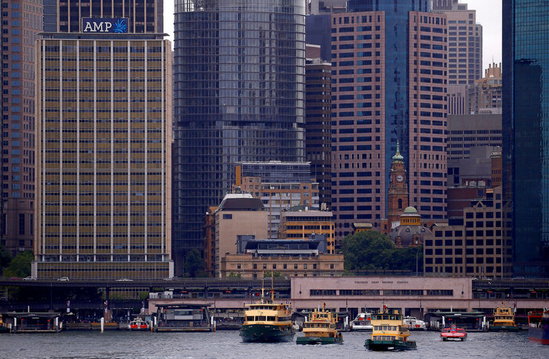 © Reuters. FILE PHOTO: The head office building of AMP Ltd, Australia's biggest retail wealth manager, is seen behind ferries docking at Sydney's Circular Quay in Australia