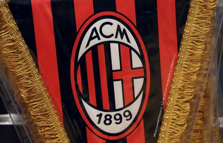 © Reuters. The AC Milan logo is pictured on a pennant in a soccer store in downtown Milan