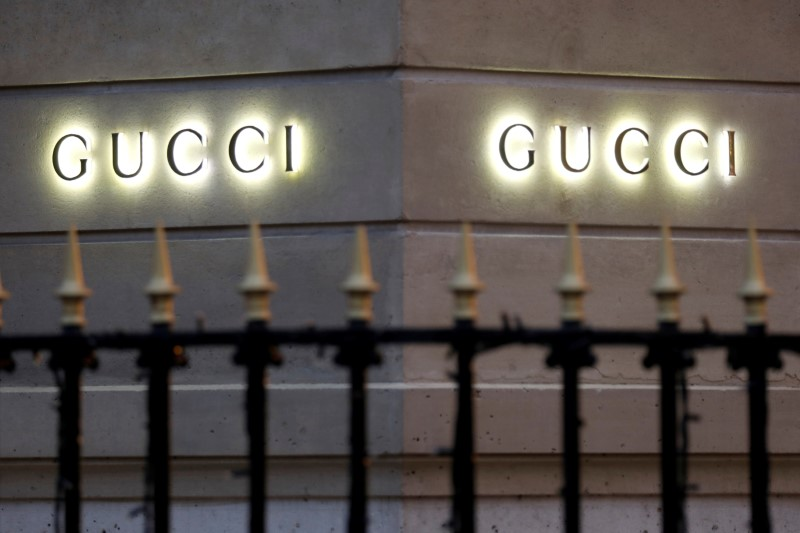 © Reuters. FILE PHOTO: Gucci signs are seen outside a shop in Paris