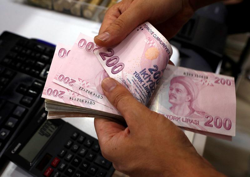 Turkey's lira, bonds hit again on U.S. trade threat, central bank worries