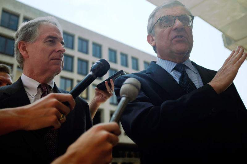 © Reuters. Peter Flaherty, Chairman of NLPC, and Paul Kamenar, attorney for Roger Stone's associate Andrew Miller, speak to reporters outside U.S. District Court n Washington