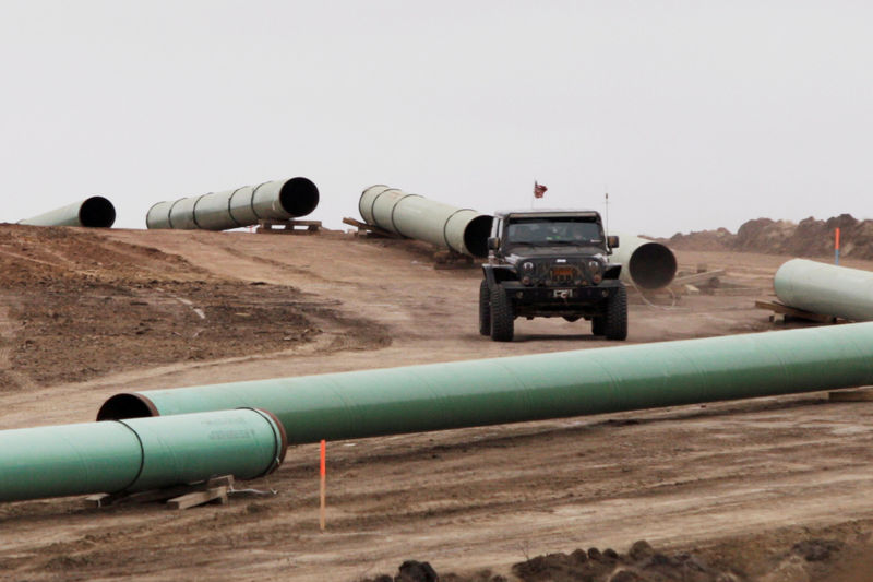 © Reuters. FILE PHOTO: A vehicle drives next to a series of pipes at a Dakota Access Construction site near the town of Cannon Ball