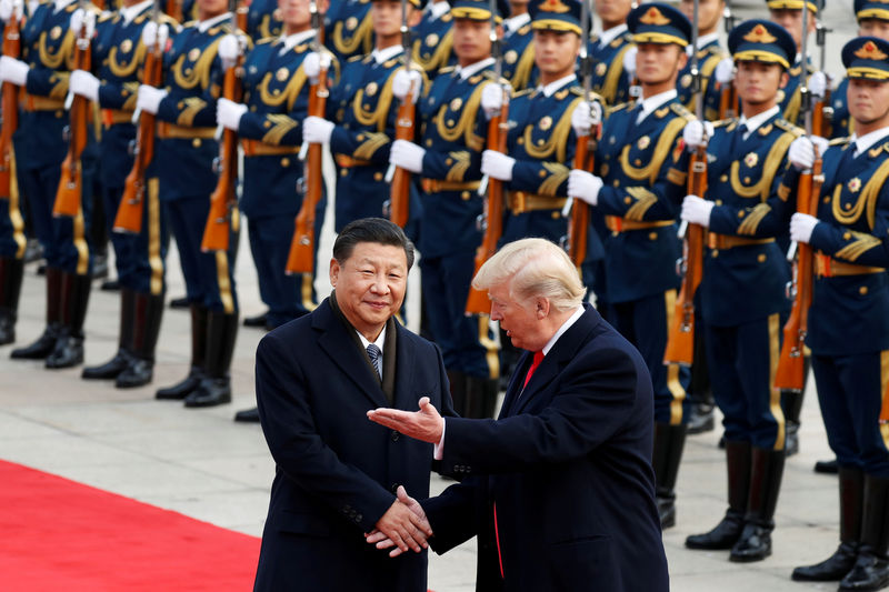 © Reuters. FILE PHOTO:  U.S. President Donald Trump takes part in a welcoming ceremony with China's President Xi Jinping in Beijing