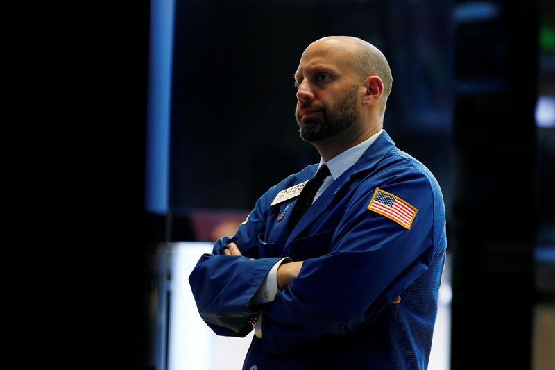© Reuters. FILE PHOTO: Specialist trader Meric Greenbaum works at his post on the floor of the NYSE in New York
