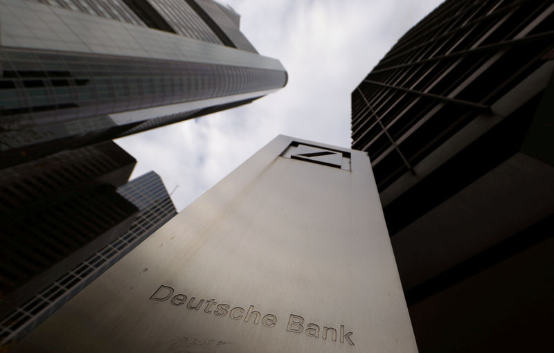 © Reuters. FILE PHOTO: The logo of Deutsche Bank is seen in front of one of the bank's office buildings in Frankfurt