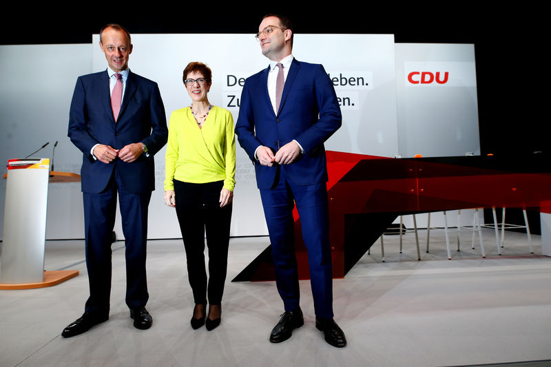© Reuters. FILE PHOTO: CDU candidates for the party chair Friedrich Merz, Annegret Kramp-Karrenbauer and Jens Spahn attend a regional conference in Duesseldorf