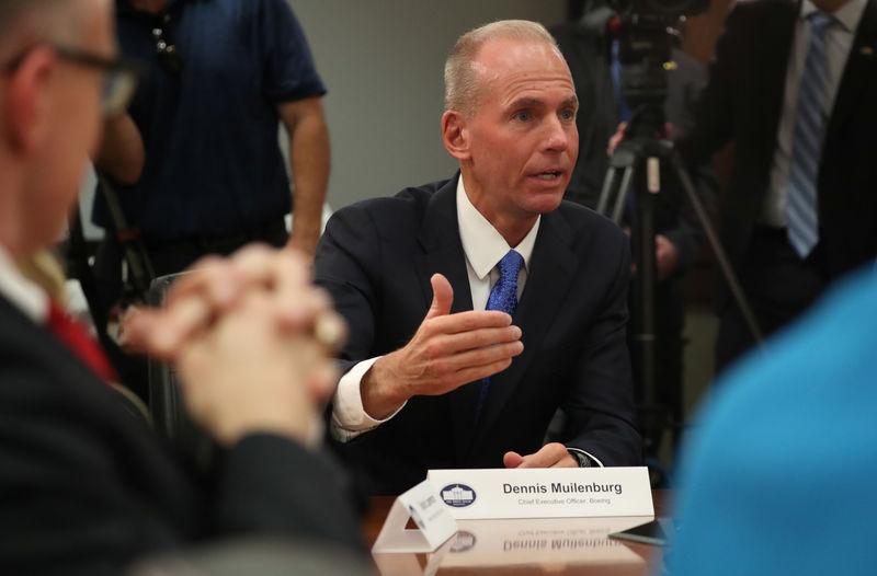 © Reuters. Dennis Muilenburg, CEO, Boeing speaks during a roundtable discussion on defense issues with U.S. President Donald Trump at Luke Air Force Base