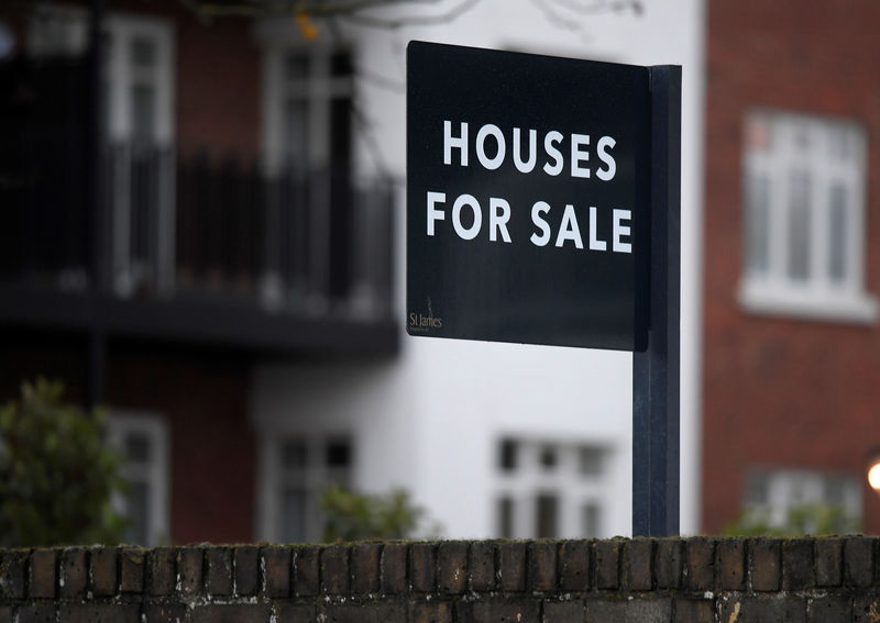 © Reuters. Property sale signs are seen outside of a group of newly built houses in west London