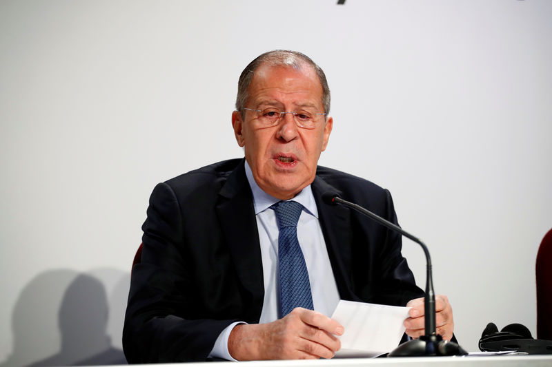 © Reuters. Russian FM Lavrov holds a news conference on the sidelines of OSCE summit in Milan