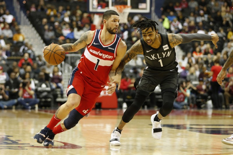 NBA notebook: Revised trade sends Ariza to Wizards, two to Suns