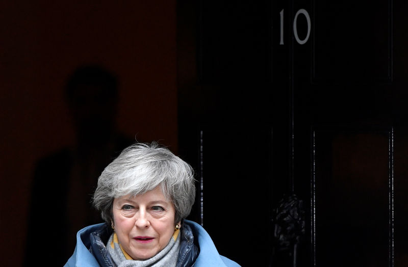 © Reuters. British PM May is seen outside Downing Street in London