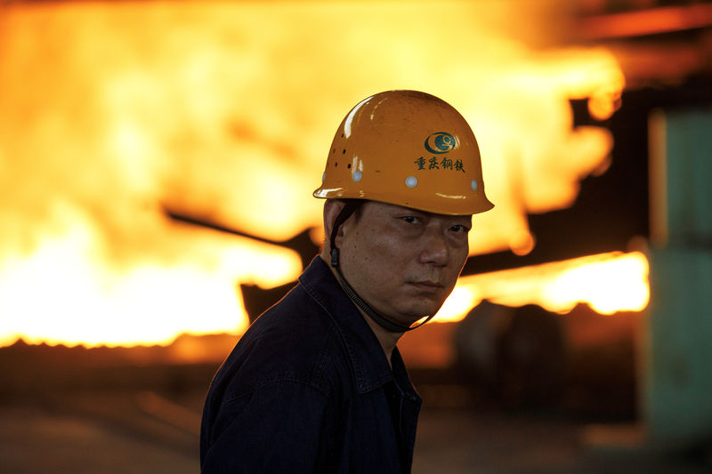 China's slowdown deepens; industrial output growth falls to 17-and-a-h