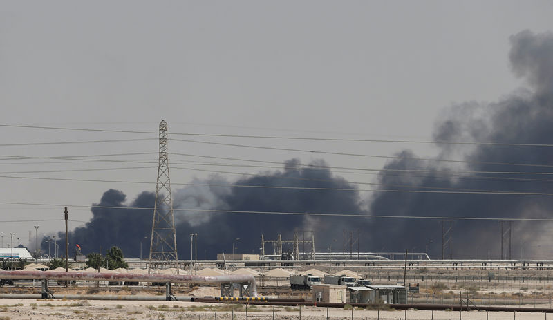 © Reuters. FILE PHOTO: Smoke is seen following a fire at Aramco facility in the eastern city of Abqaiq