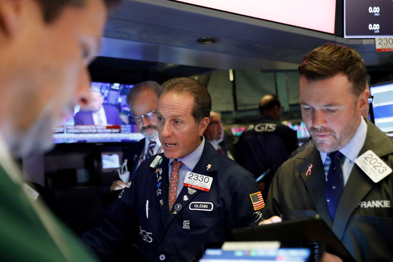 Wall Street retreats ahead of Fed decision as FedEx weighs By Reuters