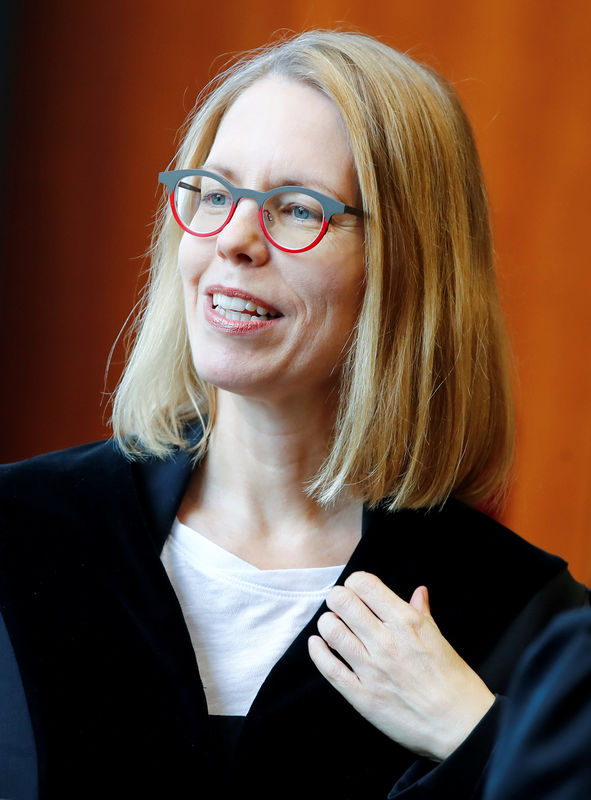 Banker tells German court of 'vast network' at center of fraud trial B