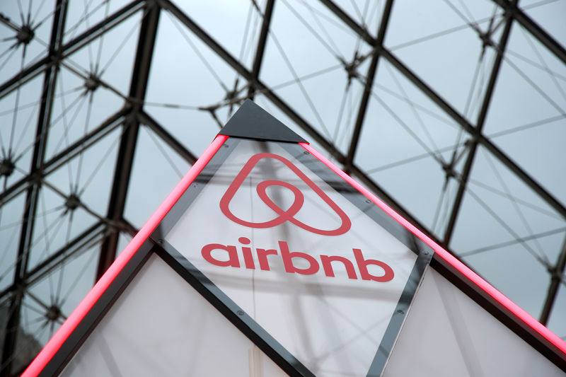 © Reuters. FILE PHOTO: Airbnb logo is seen on a little mini pyramid under the glass Pyramid of the Louvre museum in Paris