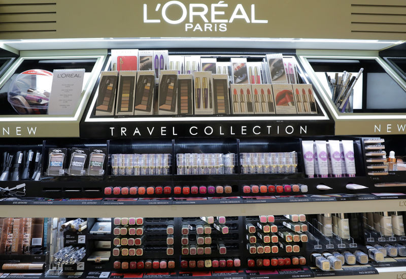 Lancome maker L'Oreal hit by £282.4 million French tax charge By Reute