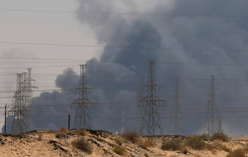 © Reuters. FILE PHOTO: Smoke is seen following a fire at an Aramco factory in Abqaiq