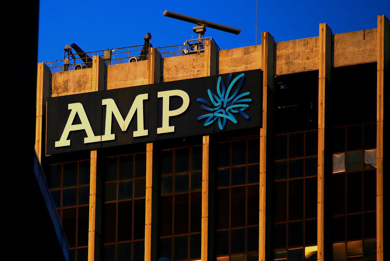 © Reuters. FILE PHOTO: The logo of AMP Ltd, Australia's biggest retail wealth manager, adorns their head office located in central Sydney, Australia