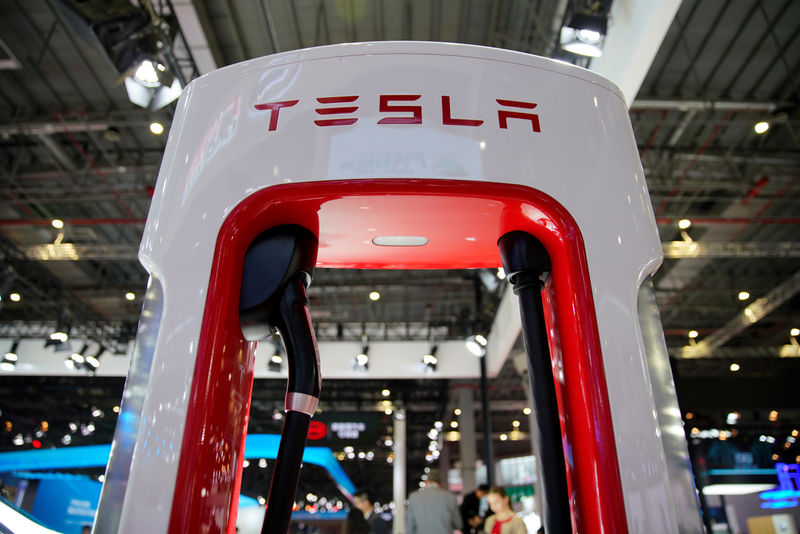 © Reuters. Tesla charging station is pictured during the media day for the Shanghai auto show in Shanghai