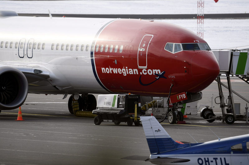 © Reuters. Grounded Boeing 737 Max 8 passenger plane of the Norwegian low-cost airline Norwegian is seen parked on the tarmac at Helsinki Airport in Vantaa