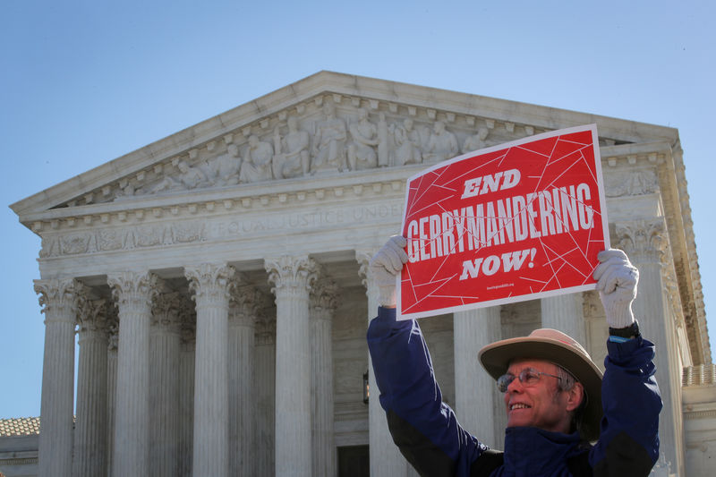 © Reuters. FILE PHOTO: A demonstrator holds a sign during a Fair Maps rally outside the U.S. Supreme Court, in Washington