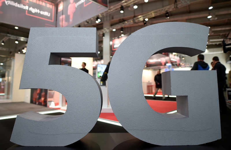 © Reuters. FILE PHOTO: A logo of the upcoming mobile standard 5G is pictured at the Hanover trade fair, in Hanover