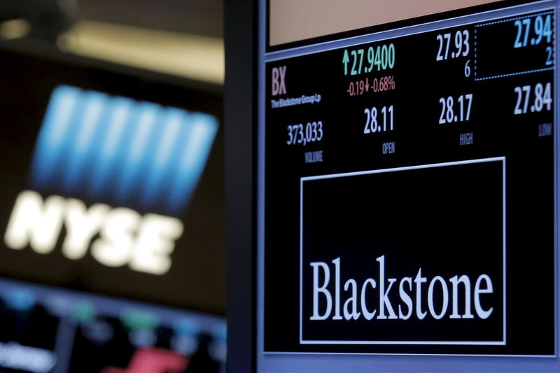 © Reuters. FILE PHOTO:  The ticker and trading information for Blackstone Group is displayed at the post where it is traded on the floor of the New York Stock Exchange