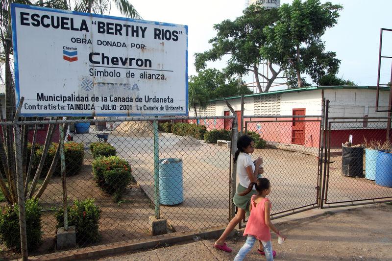 In oil-rich region, Venezuelans fear catastrophe if Trump forces Chevron to leave