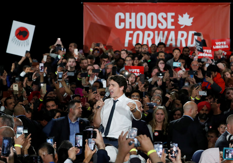 Canada`s Trudeau, main rival trade attacks as campaign grinds to conclusion