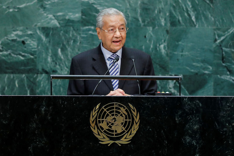 Mahathir warns of possible trade sanctions on Malaysia By Reuters