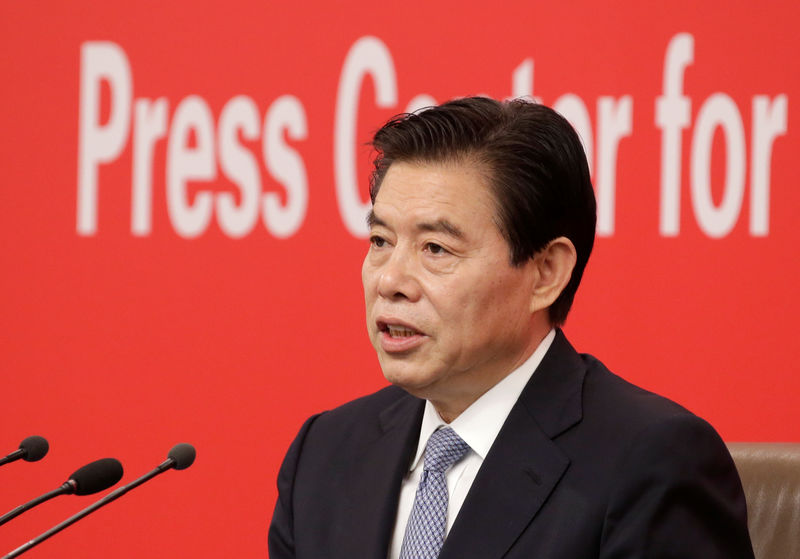 China commerce minister says new policies coming to promote trade deve