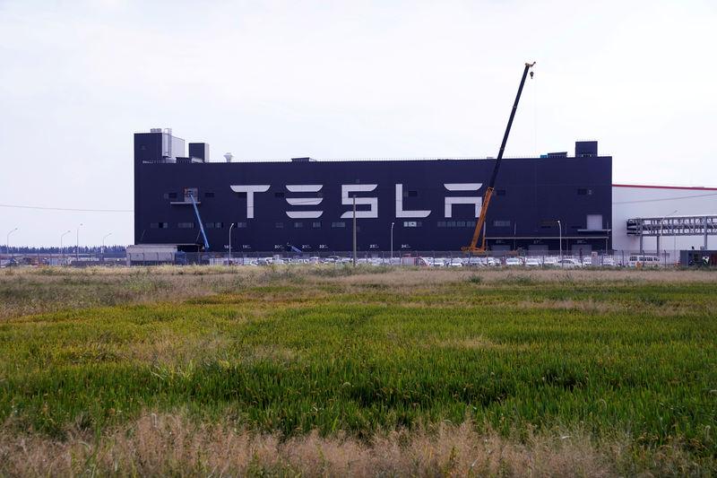 Tesla shares soar 21% as surprise profit answers sceptics By Reuters