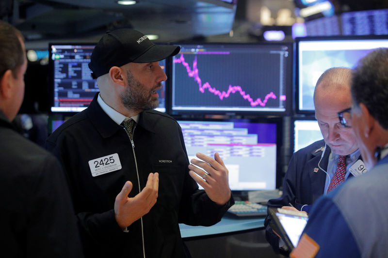 Wall St dips after S&P notches record, Fed on deck