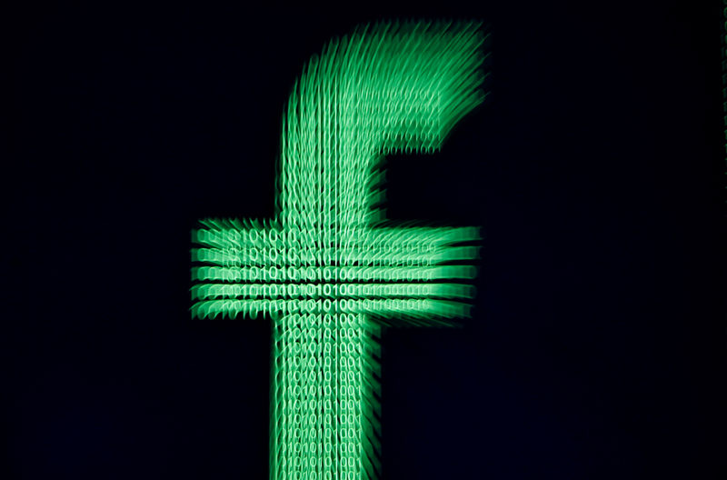 © Reuters. FILE PHOTO: A 3D-printed Facebook logo is displayed in front of binary digits in this illustration